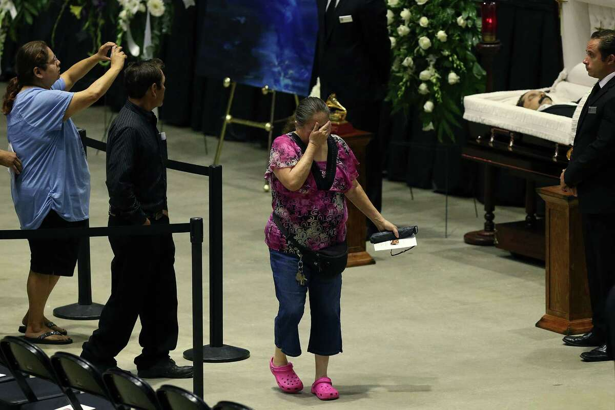 Olivia Cantu, 68, reacts after paying her respects during a visitation and rosary for Tejano music super star Emilio Navaira at the Freeman Coliseum, Sunday, May 22, 2016. Navaira died suddenly at his home in New Braunfels on May 16. Tens of thousands were expected to pay their respects during the viewing. A rosary was planned to 4 p.m.