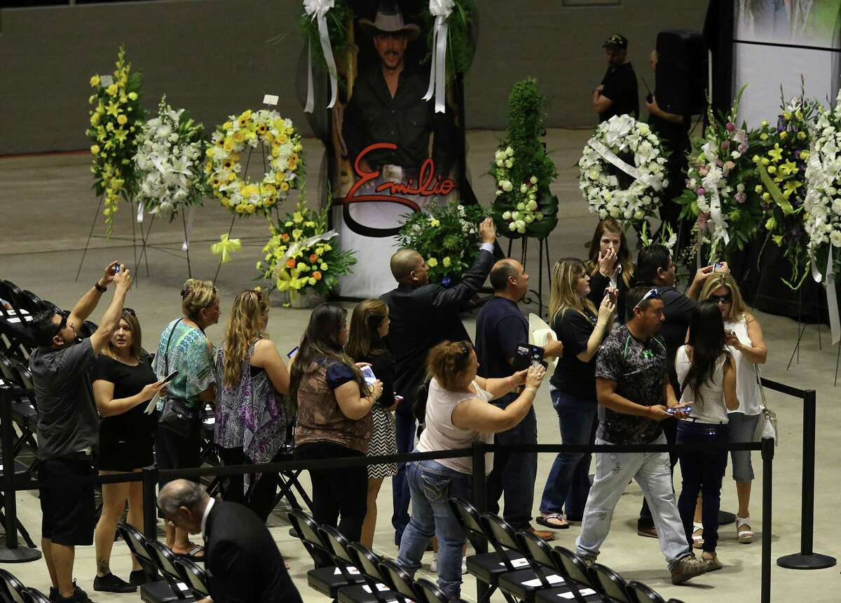 People take photographs as they line up to pay respects during a visitation and rosary for Tejano music superstar Emilio Navaira at the Freeman Coliseum, Sunday, May 22, 2016. Navaira died suddenly at his home in New Braunfels on May 16. Tens of thousands were expected to pay their respects during the viewing. A rosary was planned to 4 p.m.