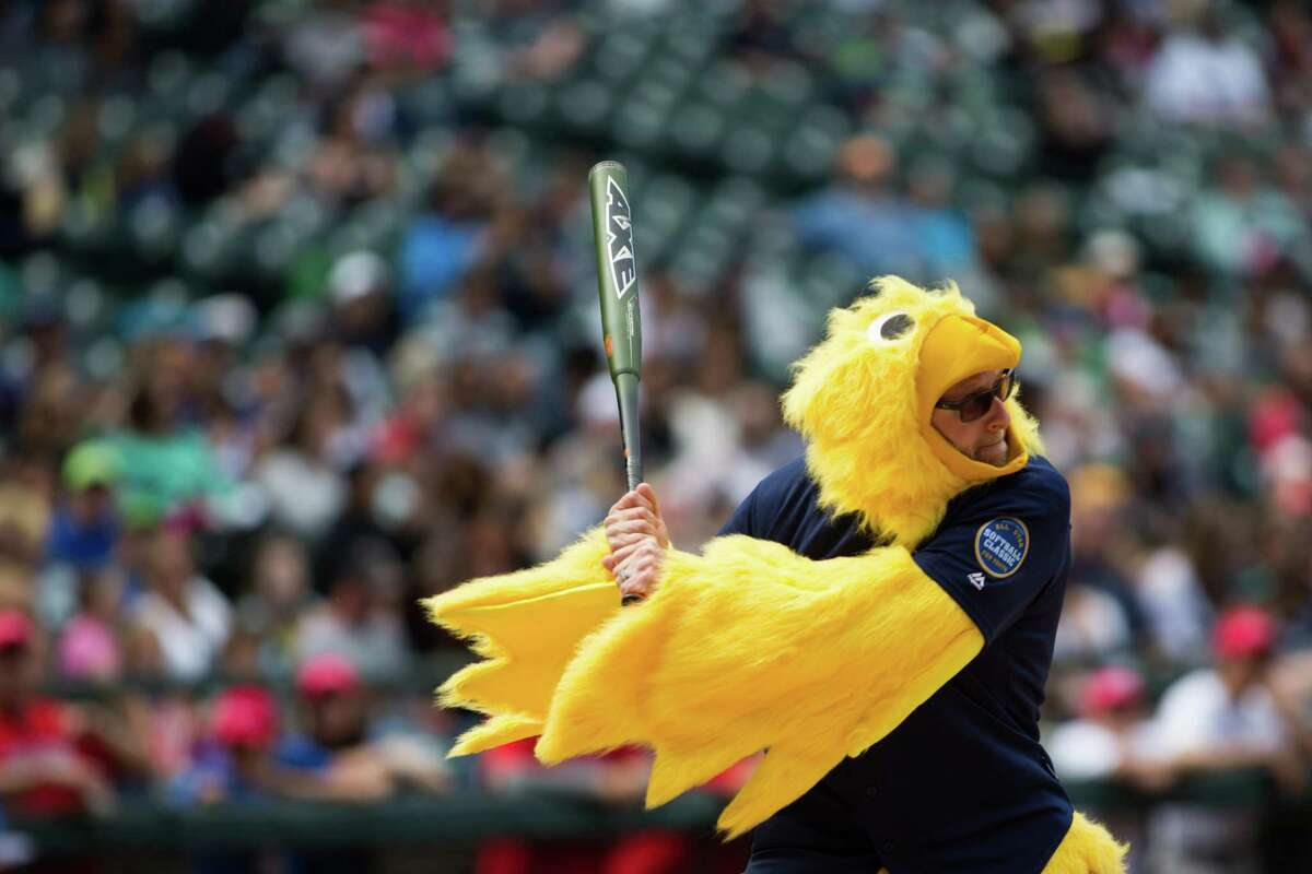 Restaurant owner Ethan Stowell takes a swing dressed up as a chicken during the All Star Softball Classic to benefit United Way King County, at Safeco Field, Sunday, May 22, 2016.