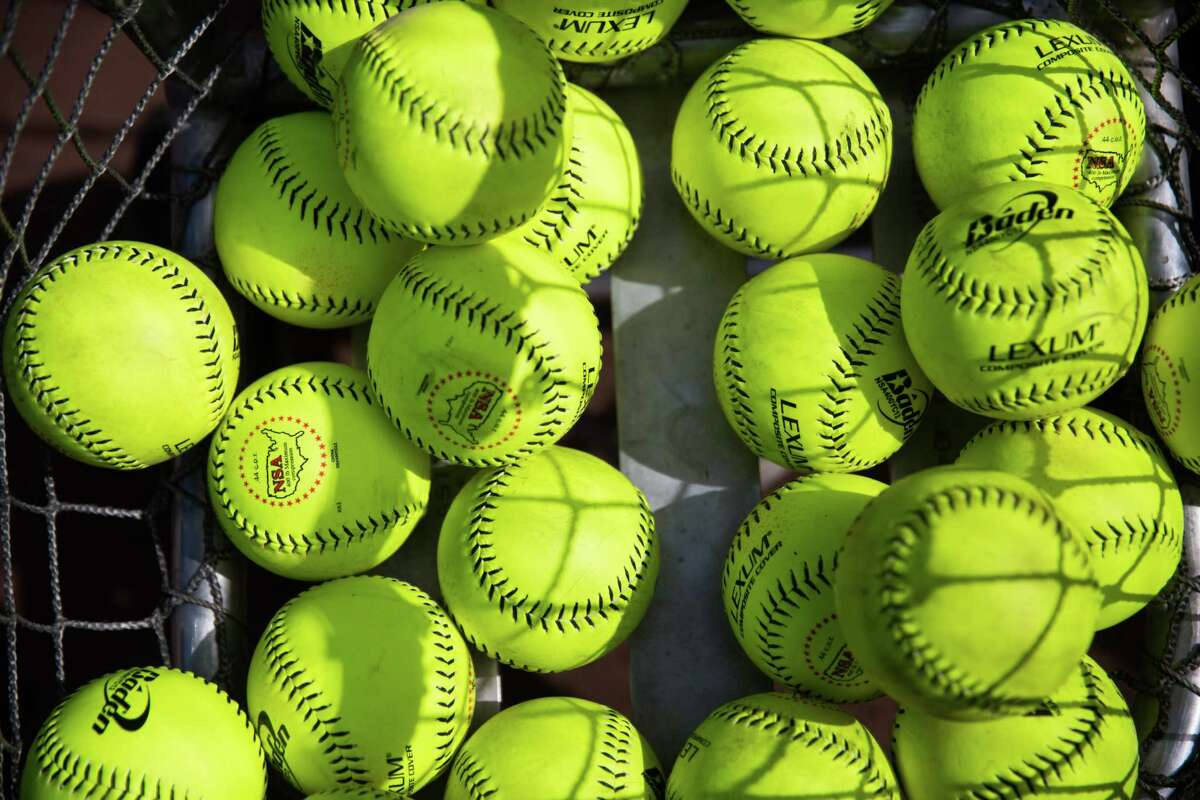 A basket of softball sits on the edge of the field during the All Star Softball Classic to benefit United Way King County, at Safeco Field, Sunday, May 22, 2016.
