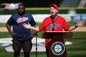 Microsoft's Brad Smith speaks before the All Star Softball Classic to benefit United Way King County, at Safeco Field, Sunday, May 22, 2016.