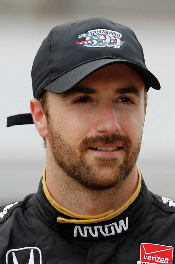 James Hinchcliffe, of Canada, poses for a photo after he qualified for the Indianapolis 500 auto race at Indianapolis Motor Speedway in Indianapolis, Saturday, May 16, 2015.  (AP Photo/Dave Parker)