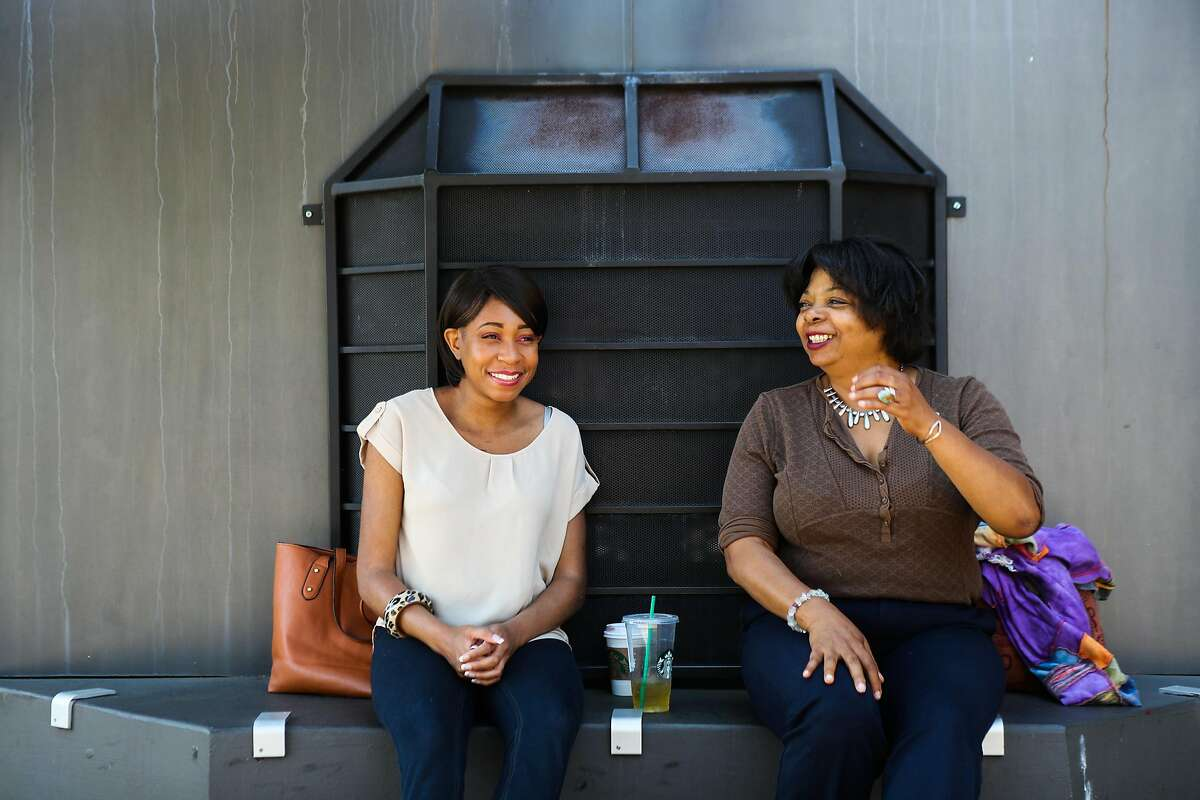 (l-r) Martina Lawson-Hines, 28, laughs as she talks to her mental health mentor Tracey Shockley, 48, in San Leandro, California, on Monday, May 16, 2016. They meet regularly at Starbucks to talk and discuss their emotions.