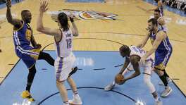 Draymond Green (23) kicks Steven Adams (12) in the groin after Adams fouled him on a shot attempt during the first half as the Golden State Warriors played the Oklahoma City Thunder in Game 3 of the Western Conference Finals  at Chesapeake Energy Arena in  Oklahoma City, Okla., on Sunday, May 22, 2016.