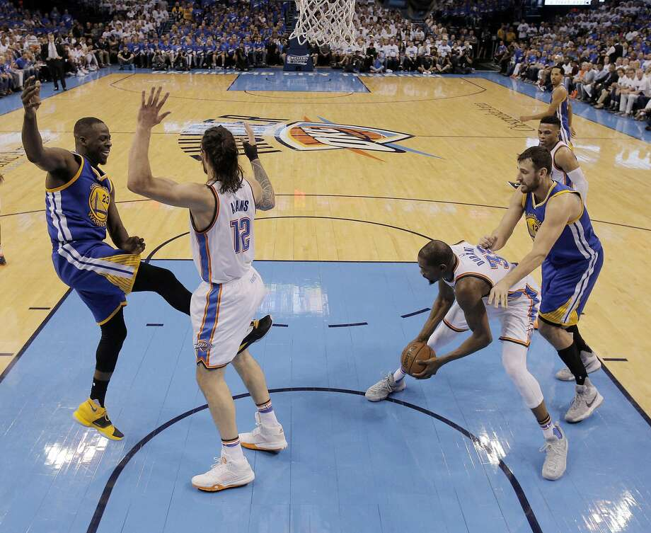 Draymond Green (23) kicks Steven Adams (12) in the groin after Adams fouled him on a shot attempt during the first half as the Golden State Warriors played the Oklahoma City Thunder in Game 3 of the Western Conference Finals  at Chesapeake Energy Arena in  Oklahoma City, Okla., on Sunday, May 22, 2016. Photo: Carlos Avila Gonzalez, The Chronicle