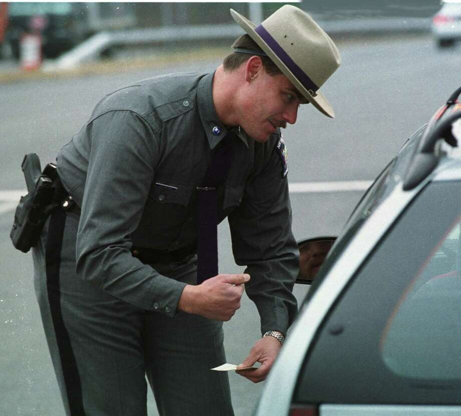 Trooper Al Witner of the New York State Police is joined by the New York Park Police and Saratoga Police preform a Zero Tolerance Seat Belt Check Point on Route 50 in Saratoga Springs New York November 23, 1999.  (Times Union Staff Photograph by Skip Dickstein) Photo: SKIP DICKSTEIN / ALBANY TIMES UNION