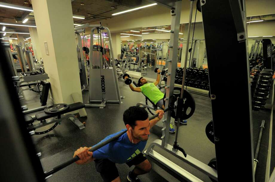 Brian Petroccio works out in the gym for residents of 75 Tresser in Stamford on May 11, 2016. Photo: Matthew Brown / Hearst Connecticut Media / Stamford Advocate