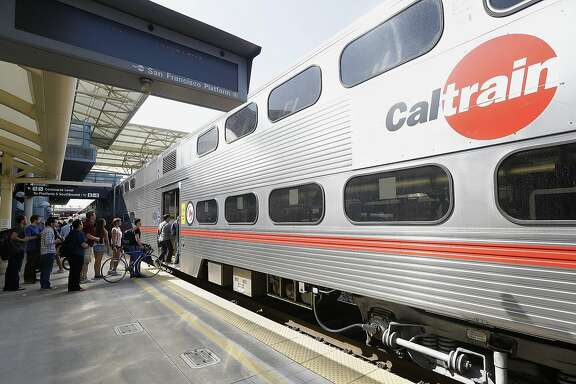 Commuters board a Caltrain train at the Caltrain and Bay Area Rapid Transit station in Millbrae, Calif., Monday, July 1, 2013. On Monday, two of San Francisco Bay Area Rapid Transit's largest unions went on strike after weekend talks with management failed to produce a new contract. (AP Photo/Jeff Chiu)