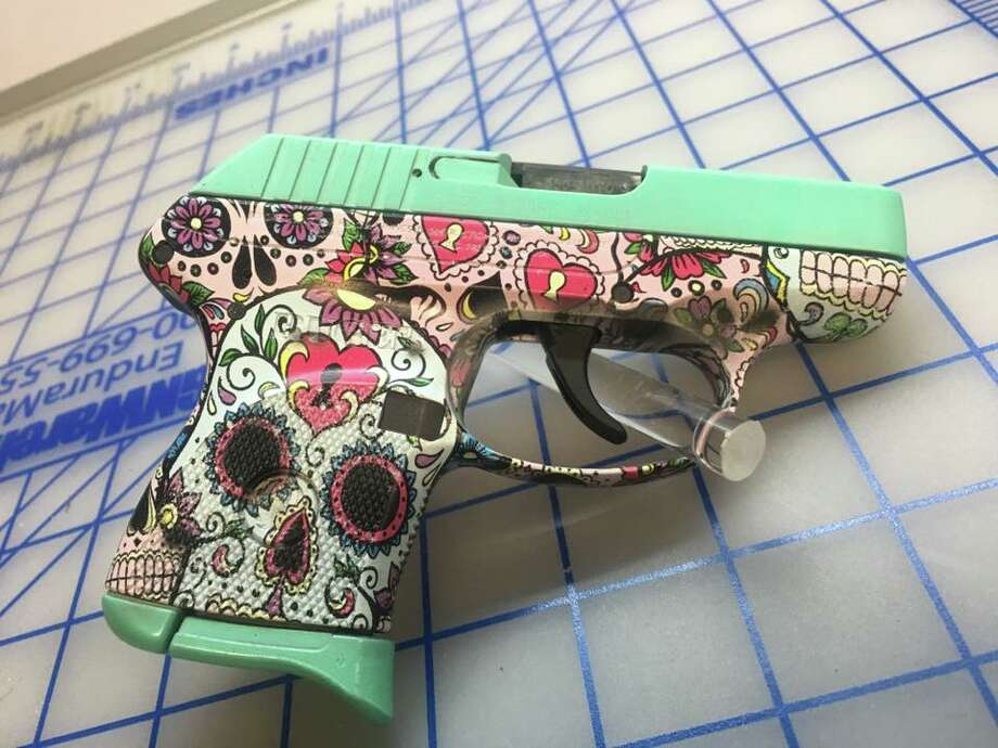 A shop in Texarkana has been making fans on social media for the unique coating system it utilizes to adorn handguns with custom designs. On its official site, Hydrographics of Texas touts pistols with camo, sugar skull designs and even one for Dallas Cowboys fans.  Photo: Hydrographics Of Texas