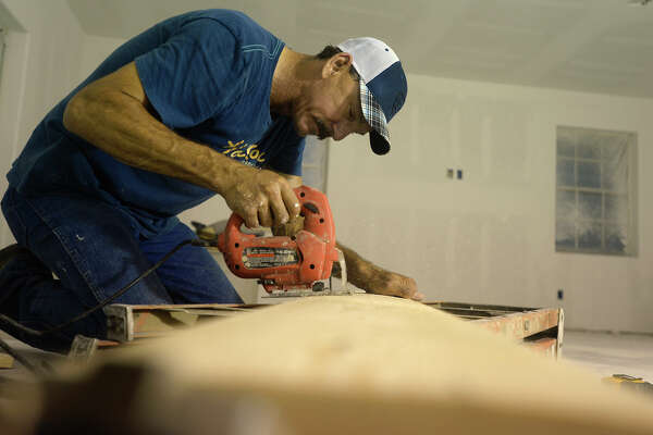 John Sims works on repairing his home in Deweyville on Thursday evening. Sims said he didn't have flood insurance because he wasn't in the flood zone.  Photo taken Thursday 5/19/16 Ryan Pelham/The Enterprise