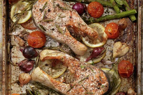 Don't have a roasting rack? Use slices of onion or lemons, then roast meat, poultry, or fish on top for extra flavor and even cooking. Here, salmon steaks top an array of fruits and vegetables. (Getty Images/Vetta)