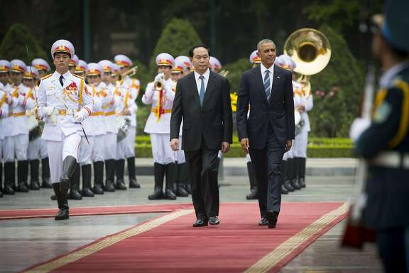 President Barack Obama and Vietnamese President Tran Dai Quang during an arrival ceremony at the Presidential Palace in Hanoi, Vietnam, May 23, 2016. The U.S. is rescinding a decades-old ban on sales of lethal military equipment to Vietnam, Obama announced at a news conference in Hanoi on Monday, ending one of the last legal vestiges of the Vietnam War. (Doug Mills/The New York Times)