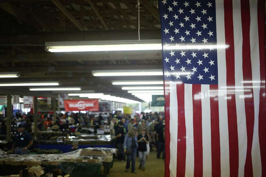 """An American flag hangs from the rafters during the Fall 2015 Knob Creek Machine Gun Shoot in West Point, Kentucky, U.S., on Friday, Oct. 9, 2015. """"Barack Obama is single handily responsible for the sales of more guns and ammo than any human being in the history of the United States,"""" said Richard Feldman, a former NRA political organizer. Hillary """"Clinton could do better."""" MUST CREDIT: Bloomberg photo by Luke Sharrett. Photo: Luke Sharrett, Bloomberg / © 2015 Bloomberg Finance LP"""