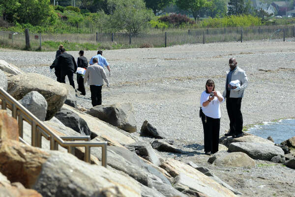 The body of a woman washed ashore near the Lordship seawall in Stratford, Conn. on Monday, May 23, 2016. Statford police and marine unit were on the scene at the foot of First Avenue and Beach Drive.