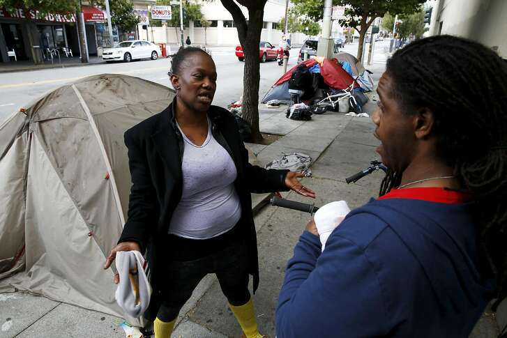 Linda Williams (left) and Haile Tillery talk beside a row of tents near Folsom and 16th streets in San Francisco, California, on Sunday, May 22, 2016.