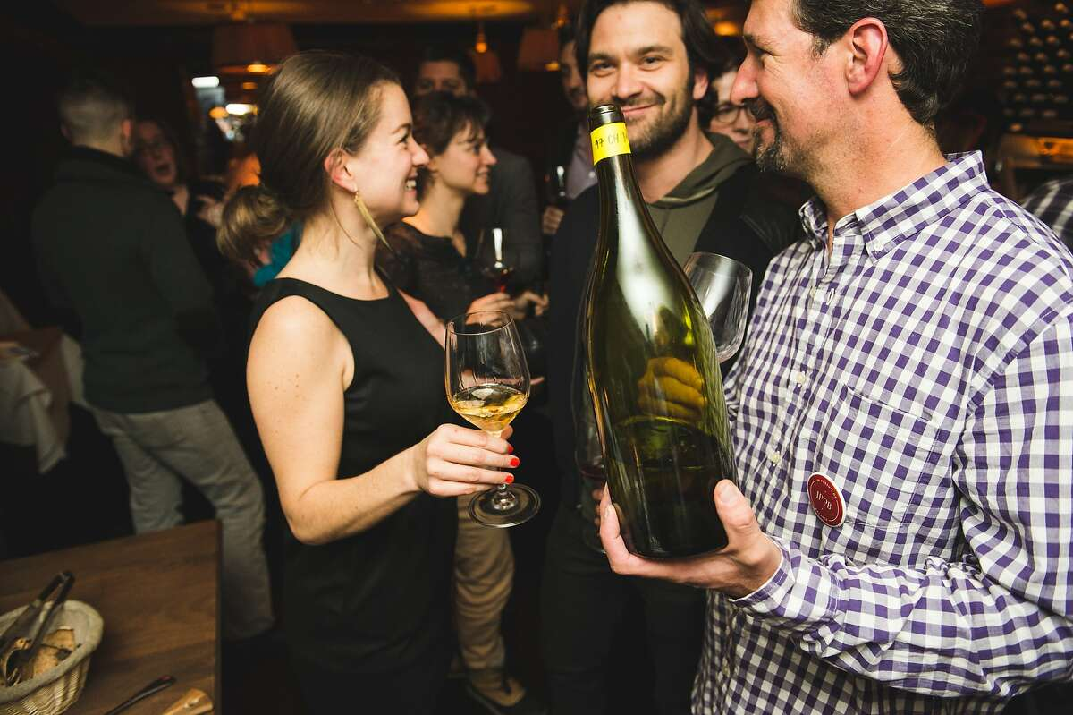 """Jasmine Hirsch, co-founder of the """"In Pursuit of Balance"""" wine group visits with others at a recent tasting of California wines."""