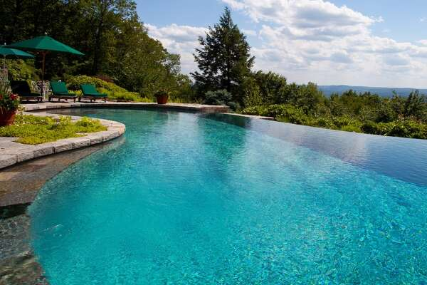 33 Ore Hill Rd, Kent, CT 06757    6 beds 9 baths 13,977 sqft   Features: Infinity pool with dramatic views, pool, house, ponds, wine cellar, artist studio   View full listing on Zillow