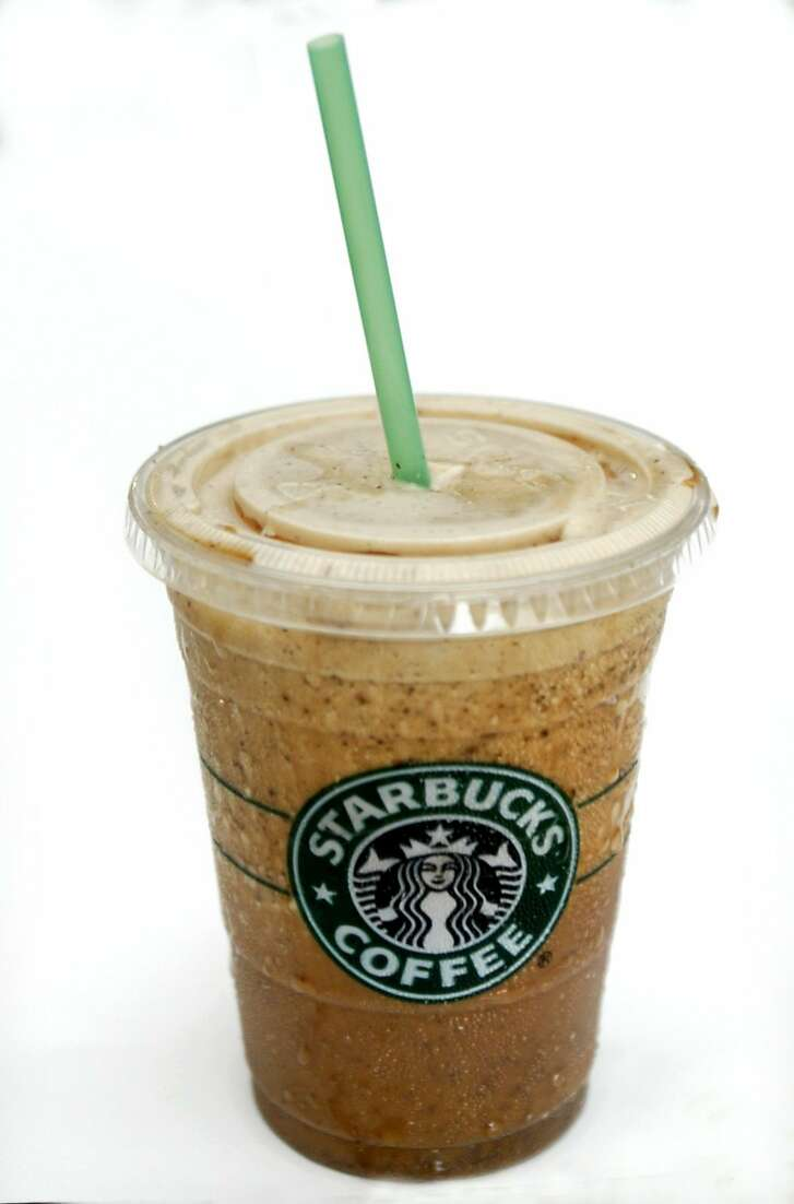 -- NO MAGS, NO SALES -- KRT LIFESTYLE STORY SLUGGED: NTR-FRAPPUCCINOS KRT PHOTOGRAPH BY NATALIE CAUDILL/DALLAS MORNING NEWS (July 9) Starbucks is the latest caloric colossus to see the lite with its new low fat Java Chip Frappucino. (nk) 2004