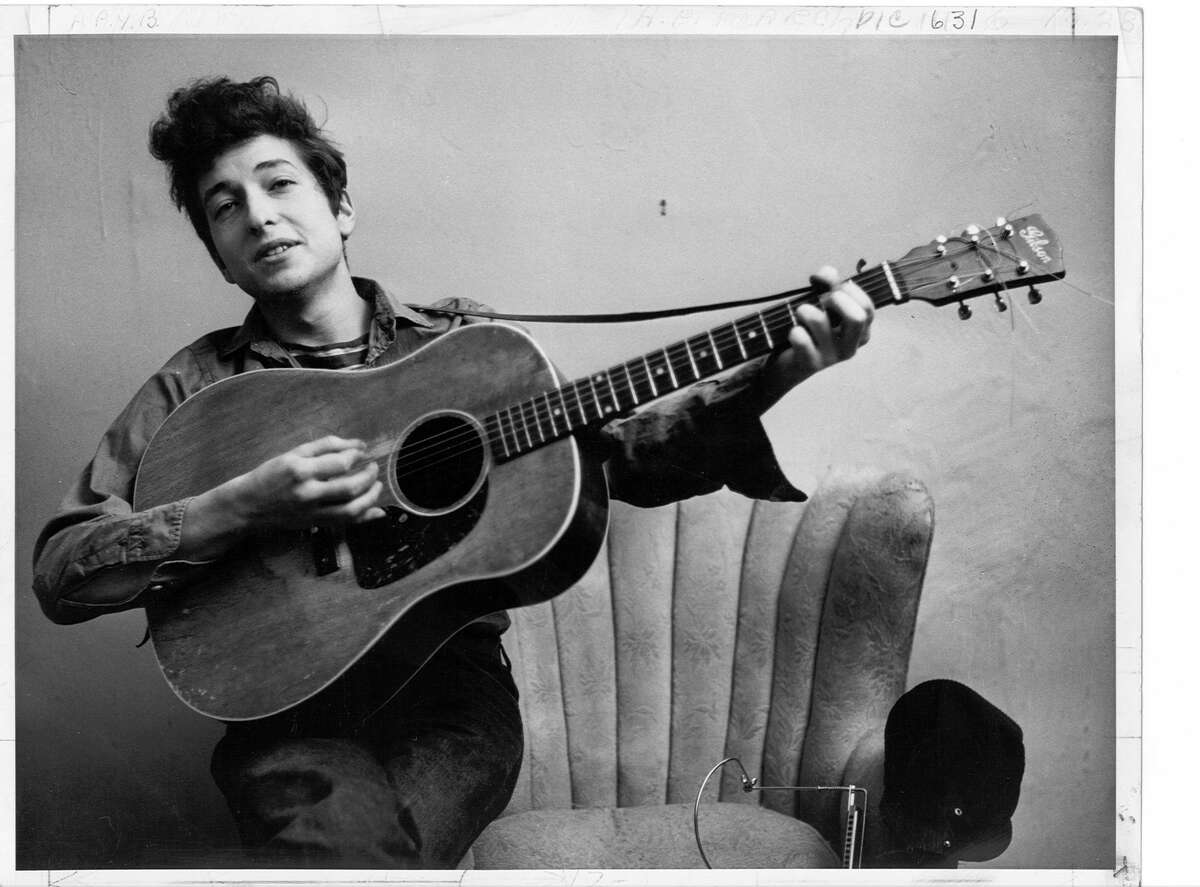 Bob Dylan poses for a portrait with his Gibson Acoustic guitar in September 1961 in New York City.