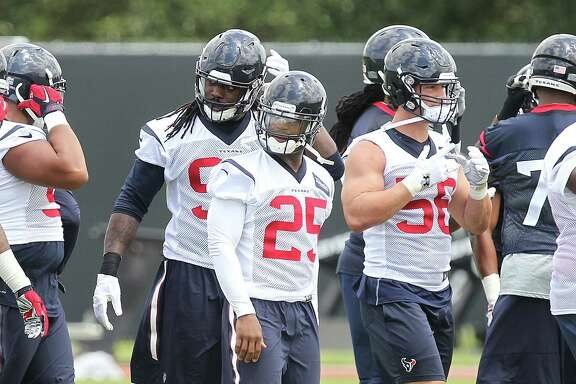 Texans CB Kareem Jackson (c) OLB Jadeveon Clowney (left) and ILB Brian Cushing participates in the first day of OTAs  Monday, May 23, 2016, in Houston.