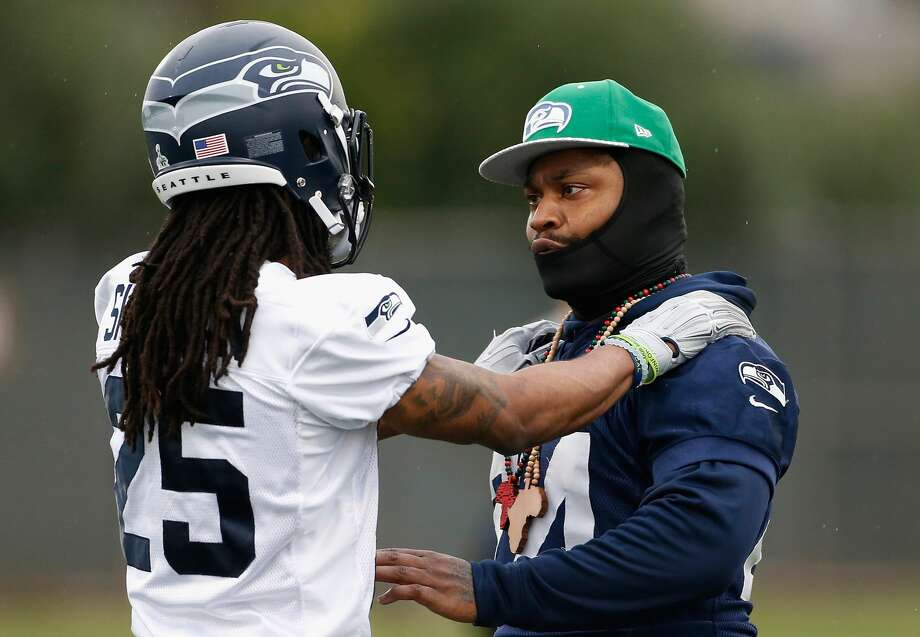 TEMPE, AZ - JANUARY 29:  Running back Marshawn Lynch #24 (R) of the Seattle Seahawks talks with cornerback Richard Sherman #25 during a practice at Arizona State University on January 29, 2015 in Tempe, Arizona.  (Photo by Christian Petersen/Getty Images) Photo: Getty Images