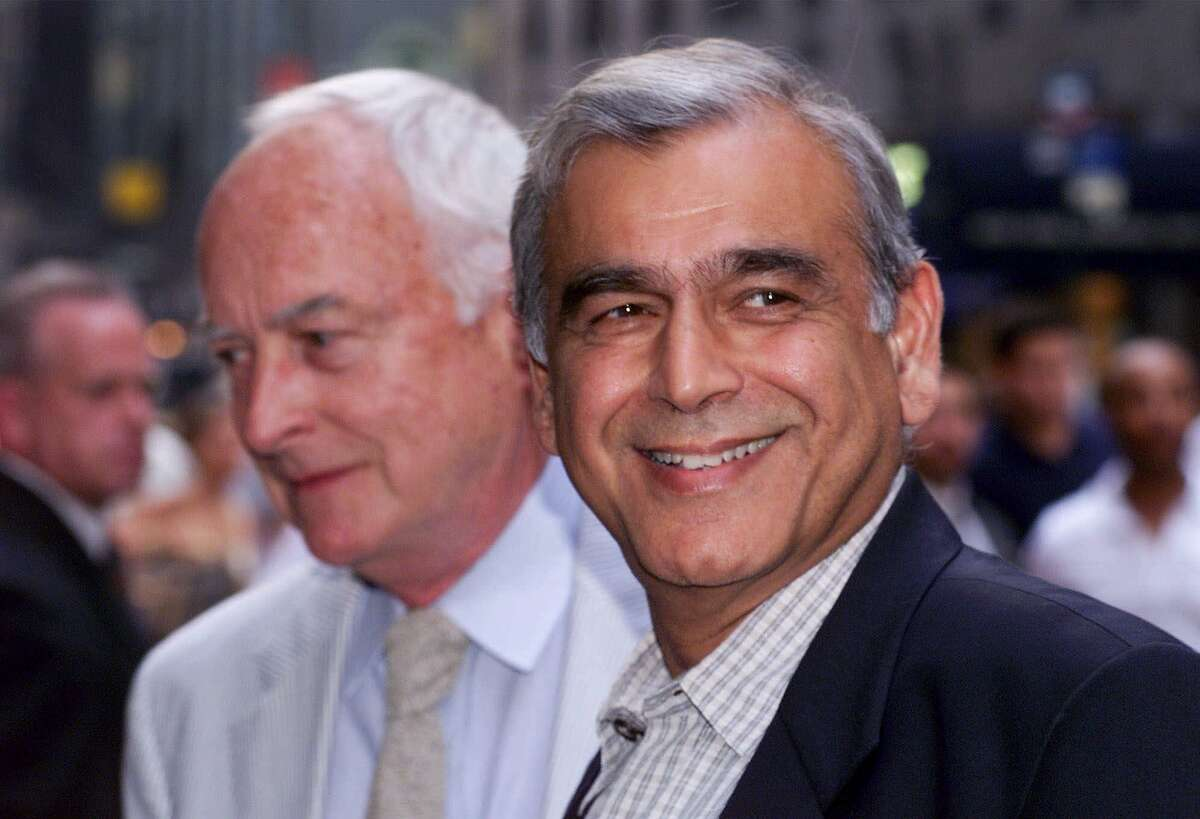 **FILE**Filmmaker Ismail Merchant,right, and his partner James Ivory, left, arrive for an auction of movie memorabilia at a New York hotel on July 27, 1999. Merchant died Wednesday, May 25, 2005, surrounded by friends and family at a hospital, Merchant-Ivory's London production office said. He was 68. (AP Photo/Mark Lennihan)
