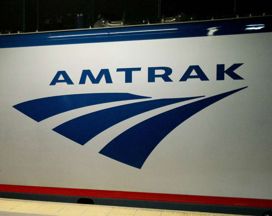 FILE - In this Feb. 6, 2014 file photo, an Amtrak logo is seen on a train at 30th Street Station in Philadelphia. A federal appeals court has once again ruled that Congress can�t give Amtrak power to impose rail standards on other private railroads. The U.S. Court of Appeals for the District of Columbia Circuit ruled Friday, April 29, 2016, it is unconstitutional to give a �self-interested� company regulatory power over competitors , even if Amtrak is a public-private hybrid. (AP Photo/Matt Rourke, File) Photo: Matt Rourke, Associated Press