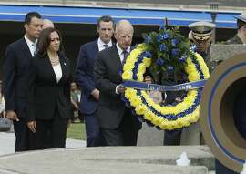 California Gov. Jerry Brown and California Highway Patrol Commissioner Joe Farrow carry a wreath to the Memorial Fountain during annual California Highway Patrol Memorial Service Tuesday, May 3, 2016, in West Sacramento, Calif. The annual event, held at the CHP academy, honors those officers who died in the law of duty.  Also seen are Secretary of State Alex Padilla,left, Attorney General Kamala Harris, second from left and Lt.  Gov. Gavin Newsom, third from left.(AP Photo/Rich Pedroncelli)