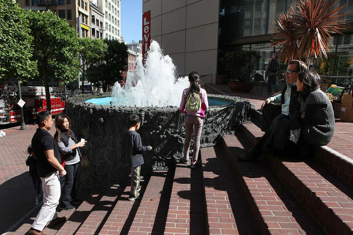 Visitors enjoy Ruth Asawa's 'Hyatt on Union Square Fountain' at the triangular plaza behind the Levi's store in San Francisco, Calif., on Friday, May 24, 2013. The Levi store will soon be replaced by a new Apple Store where plans apparently seem to remove the fountain.