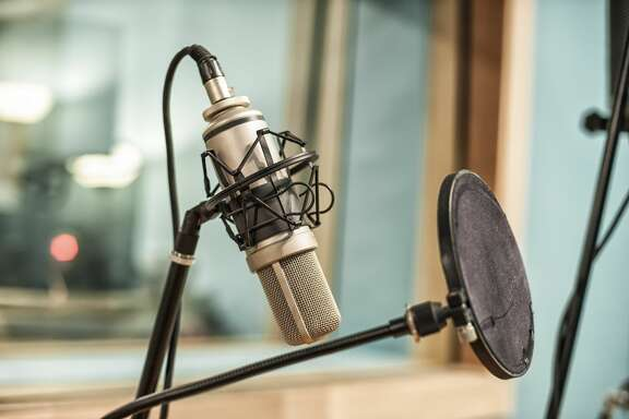 Microphone and pop filter in recording studio.View my lightbox: