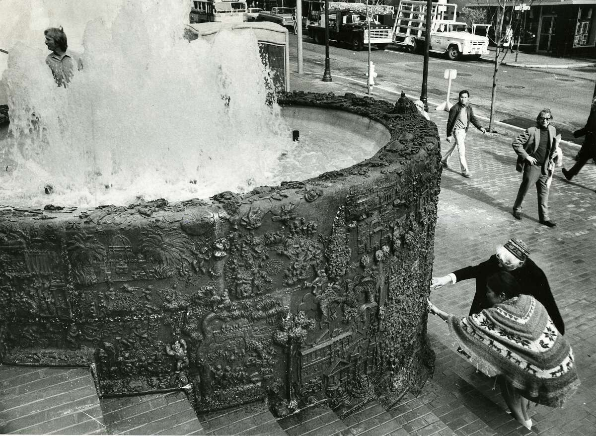 Sculptor Ruth Asawa and photographer Imogen Cunningham view details from Asawa's whimsical fountain on the plaza at the Hyatt Hotel at Union Square in 1973. Preliminary plans to relocate the downtown Apple Store to the site may mean the fountain would be dismantled.