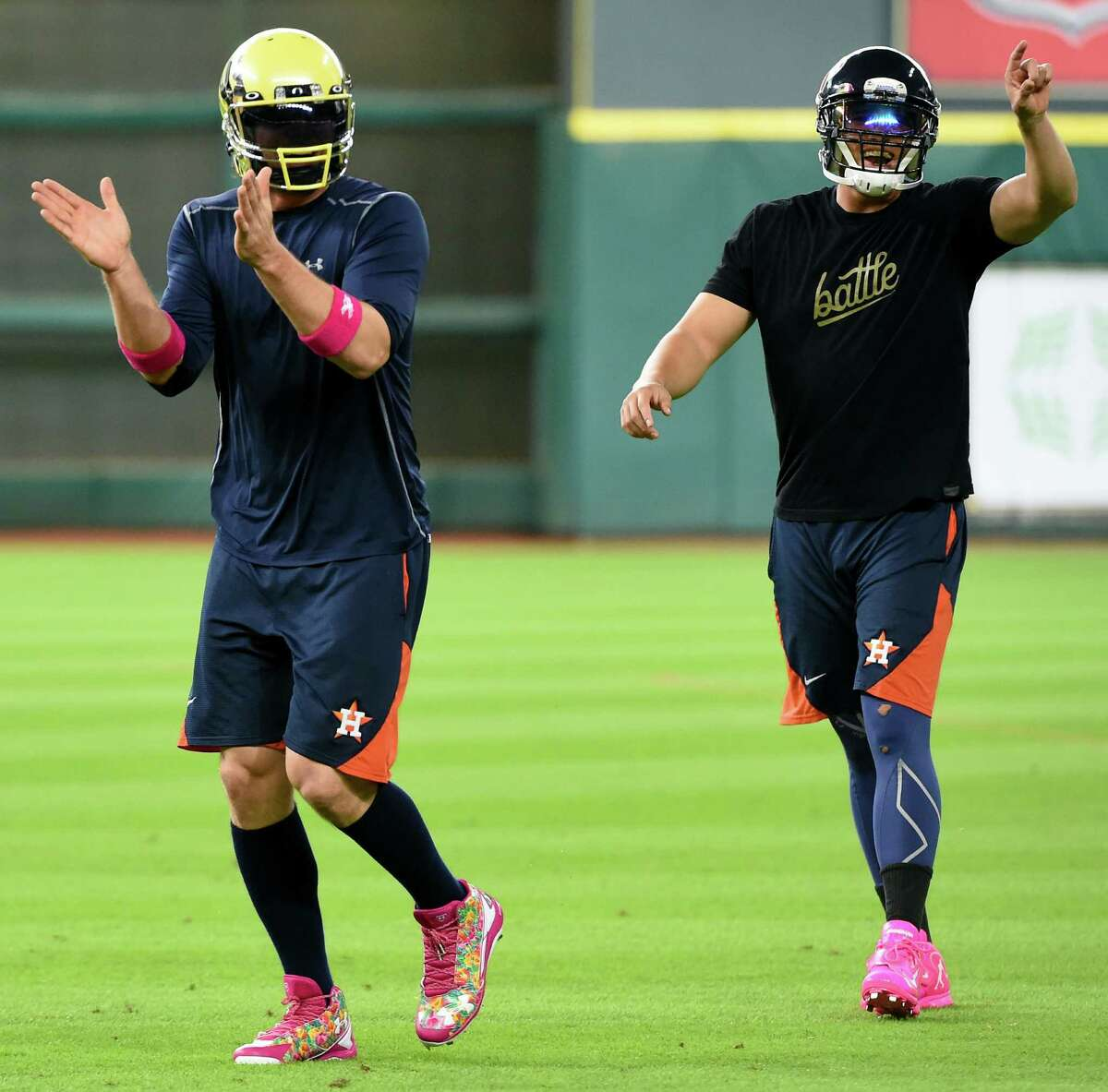 No football allowed Before games, George Springer and Jake Marisnick have taken to playing catch with a football at Minute Maid Park. Sometimes they even go all out and wear football helmets - Marisnick with a helmet from his beloved Oregon Ducks and Springer usually sticking with the hometown Houston Texans. Baseball gods aren't fans of anything other than the American Pastime being played on their hallowed grounds.