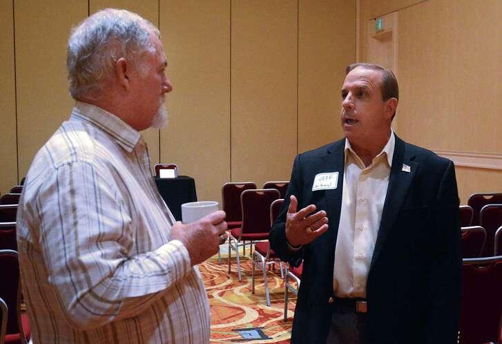 Robert Wozencrap, left, listens to panel member Jeff Presnal during a session for veterans on entrepreneurship and leadership opportunities.