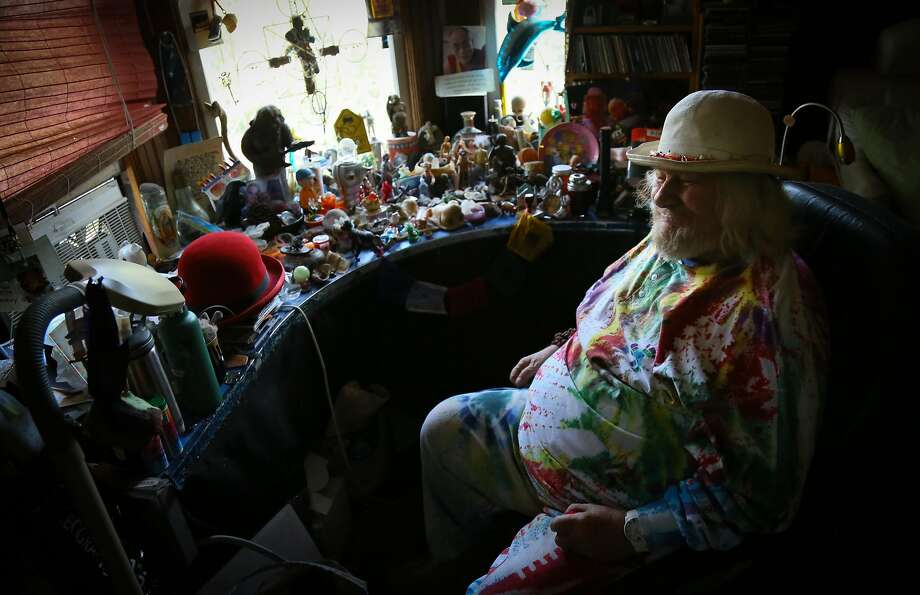 "Hugh ""Wavy Gravy"" Romney talks about the collection of toys and trinkets on his desk at his home in Berkeley. Photo: Brian Feulner, Special To The Chronicle"