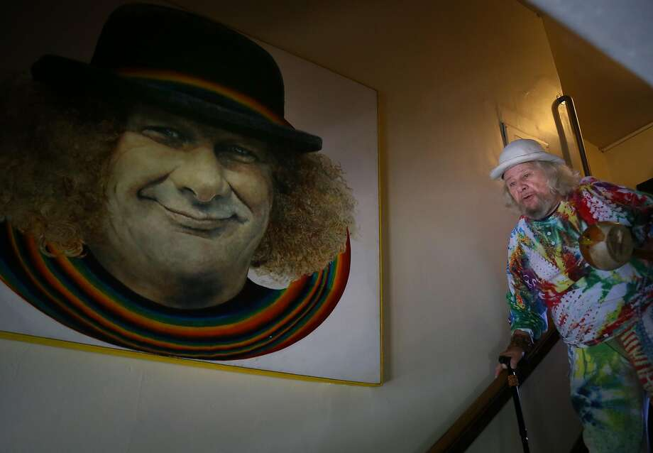 "Hugh ""Wavy Gravy"" Romney walks down the stairs of his home in Berkeley on his way out to his annual birthday concert fundraiser. Photo: Brian Feulner, Special To The Chronicle"