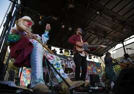 """Hugh """"Wavy Gravy"""" Romney performs on stage with the Yonder Mountain String Band during his 80th birthday celebration concert and fundraiser for the Seva Foundation Sunday, May 22, 2016 at the event center at Sonoma Mountain Village in Ronhert Park, Calif.  Brian Feulner, Special to the Chronicle"""