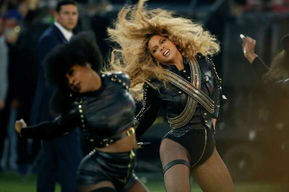 "FILE - In this Feb. 7, 2016 file photo, Beyonce performs during halftime of the NFL Super Bowl 50 football game in Santa Clara, Calif. Dierks Bentley, Karen Fairchild and more country artists are welcoming Beyonce's excursion into country music with song ""Daddy Lessons"" from her new album ""Lemonade."" The acoustic guitar-driven song mixes New Orleans horns and country lyrics that many in Nashville say is a bona fide country tune. (AP Photo/Matt Slocum, File)"