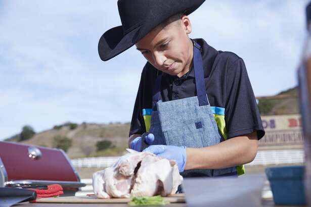 Contestant Ty Machado prepares his dish for the Chicken BBQ Challenge, as seen on Food Network's Kids BBQ Challenge Season 1.