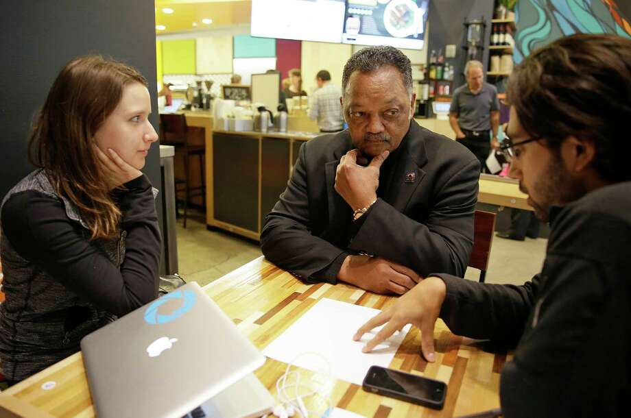 In 2014, the Rev. Jesse Jackson visited Kacie Gonzalez, left, vice president of business development, and Nick Norena, both with the company Shoto, in San Francisco. Jackson has pushed the technology industry to confront a shortage of women, African-Americans and Hispanics on their payrolls. Photo: Eric Risberg, STF / AP