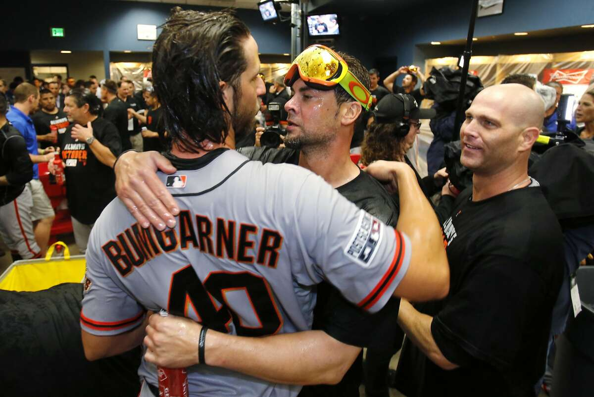 San Francisco Giants starting pitcher Madison Bumgarner (40) celebrates with fellow pitchers Ryan Vogelsong, center, and Tim Hudson, right, after pitching the Giants to an 8-0 win over the Pittsburgh Pirates in the National League wild-card playoff baseball game in Pittsburgh on Wednesday, Oct. 1, 2014. (AP Photo/Gene J. Puskar)