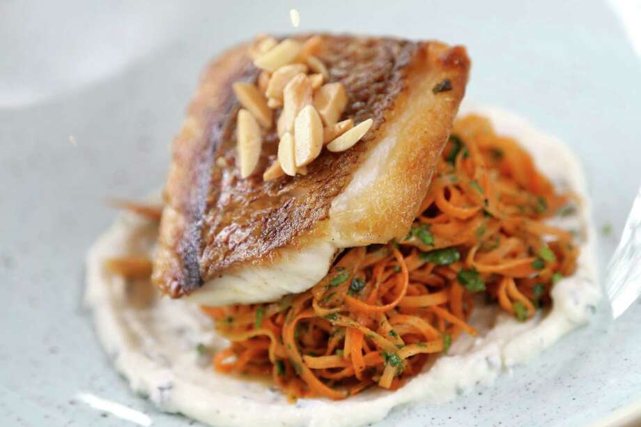 Pan seared gulf snapper with sweet potato cacio e pepe, lemon herb ricotta and toasted almonds at Bernadine's Photo: Gary Coronado, Staff / © 2015 Houston Chronicle