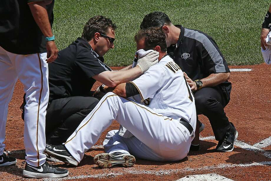 Pittsburgh Pirates pitcher Ryan Vogelsong, center, is helped by team trainers after being hit in the head by a pitch from starting pitcher Jordan Lyles in the second inning of a baseball game in Pittsburgh, Monday, May 23, 2016. The Pirates won 6-3. (AP Photo/Gene J. Puskar) Photo: Gene J. Puskar, Associated Press