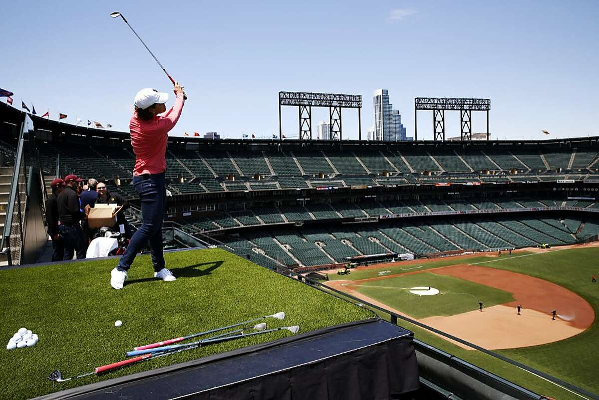Golfer Juli Inkster hits a practice ball before a skills competition against Giants players at the Women's U.S. Open media day at AT&T Park in San Francisco, California, on Monday, May 23, 2016.
