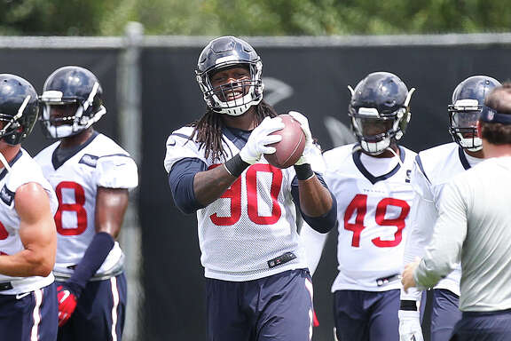 Texans linebacker Jadeveon Clowney (90) participates in the first day of OTAs on May 23, 2016, in Houston.