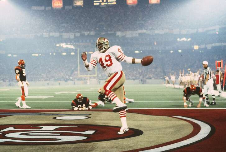 PONTIAC, MI - JANUARY 24: Earl Cooper #49 of the San Francisco 49ers celebrates after scoring a touchdown against the Cincinnati Bengals in Super Bowl XVI on January 24, 1982 at the Silver Dome in Pontiac, Michigan. The Niners won the Super Bowl 26 -21. (Photo by Focus on Sport/Getty Images)