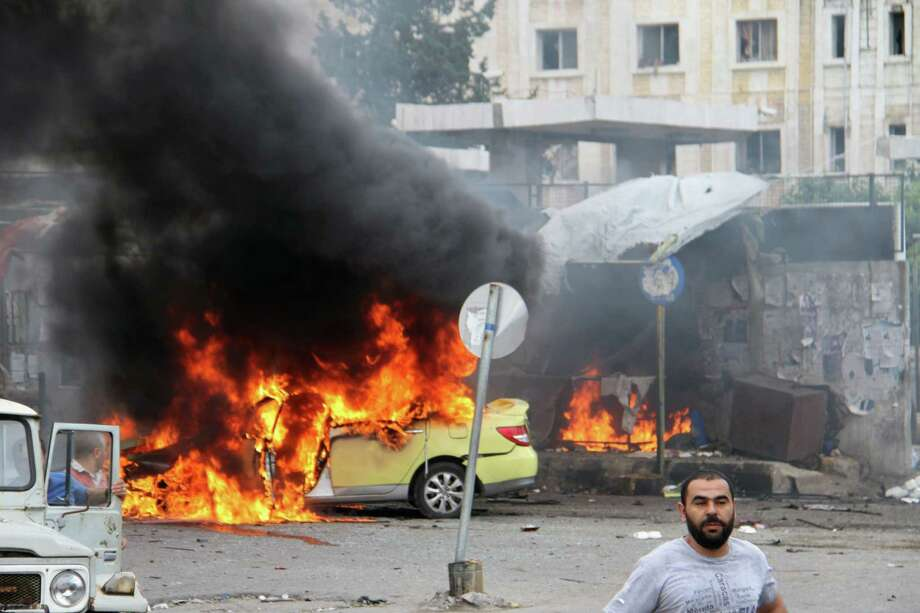 Flames rage at the scene of multiple bombings in Tartus, Syria, on Monday. The Islamic State group claimed responsibility for coordinated blasts in Jableh and Tartus. Targets included bus stations and a hospital. Photo: -, Stringer / AFP
