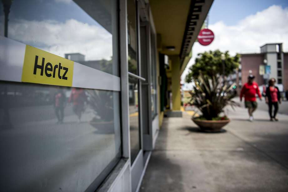 Pedestrians walk past a Hertz Global Holdings Inc. car rental location in San Francisco, California, U.S., on Thursday, May 5, 2016. Hertz is scheduled to release earnings figures on May 9. Photographer: David Paul Morris/Bloomberg Photo: David Paul Morris, Bloomberg