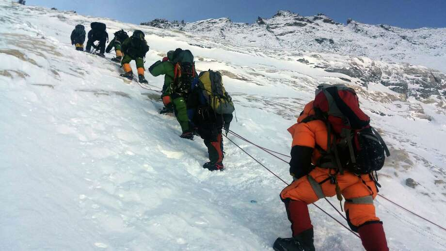 Experts say poor planning and overcowding on Mount Everest are likely to blame for the recent deaths of three climbers and possibly two others. mit of Mount Everest.  An Indian mountaineer has died on Mount Everest and two of his teammates are missing, expedition organisers said May 23, 2016, as the death toll from the Himalayan climbing season rose to five. Subhash Pal reached the 8,848-metre (29,029-foot) summit on May 21, but collapsed while descending the Hillary Step ice wall and died the following day. He was the third to die on Everest in recent days, after an Australian and a Dutch climber succumbed to altitude sickness. Another two climbers have died on other peaks.  / AFP PHOTO / NIMA GYALZEN SHERPANIMA GYALZEN SHERPA/AFP/Getty Images Photo: NIMA GYALZEN SHERPA, Stringer / AFP or licensors