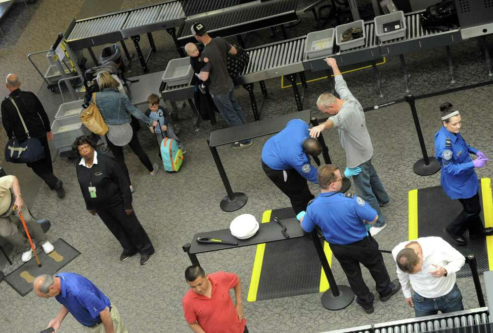 Travelers pass through the TSA security check point at Albany International Airport on Thursday May 19, 2016 in Colonie, N.Y. (Michael P. Farrell/Times Union)