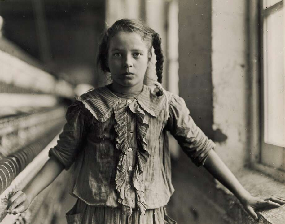 Lewis Hine's 1908 gelatin silver print of Cora Lee Griffin, one of the young spinners in the Whitnel Cotton Manufac turing Co.'s North Carolina plant, captures the reality of child labor. Photo: Bruce White, Princeton University Art Museum. Anonymous Gift